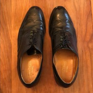 Worn Johnson and Murphy black shoes